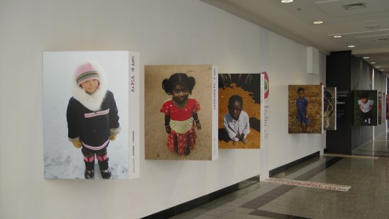 Portraits of children on the top floor of the Eaton Centre.