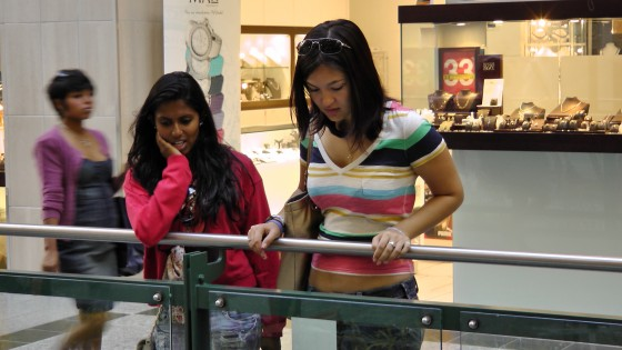 "Some more shoppers looking at ""Fragile"" by Roadsworth and Brian Armstrong at the Eaton Centre."