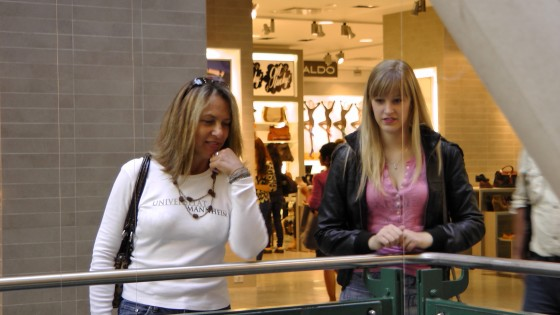 "Some shoppers looking at ""Fragile"" by Roadsworth and Brian Armstrong at the Eaton Centre."