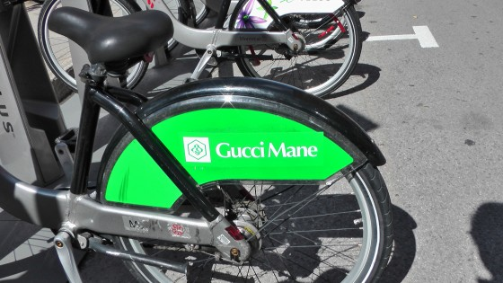 Gucci Mane on the back of a Bixi.