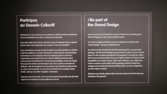 Wall tag explaining how to interact with Grand Design By Isabel Vinuela
