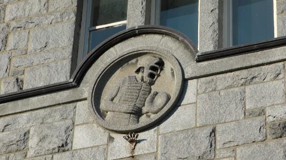 Baseball player bas-relief above an entrance to the Centre Culturel Calixa-Lavallée
